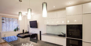 kitchen with pendant lights and tv